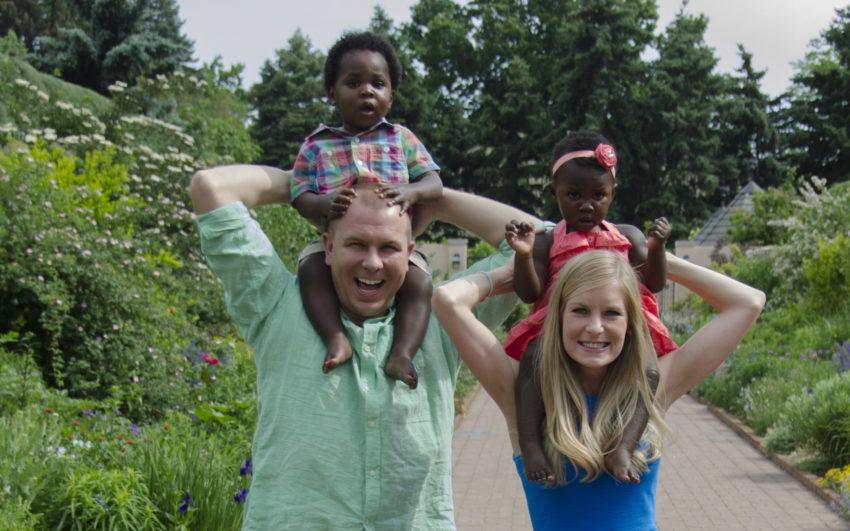 family-summer-park-holding